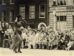 Photo:Limbo dancer at the 1955 Soho Fair. Photograph by Dennis Parr